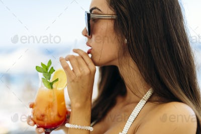 Beautiful woman drinking cocktail