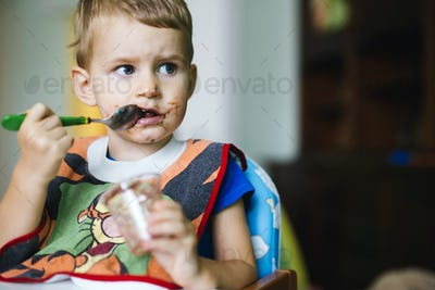 Smeared child eating