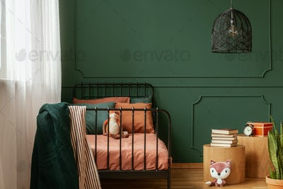 Real photo of a cute, green and orange bedroom