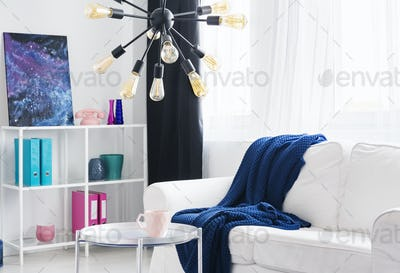 Blue blanket on white couch