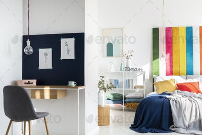 Colorful bedroom interior with king size bed and home office