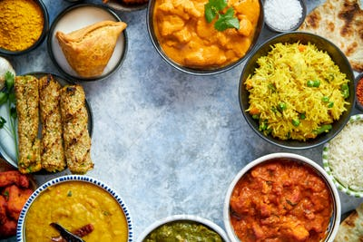 Assorted indian food on stone background. Dishes of indian cuisine