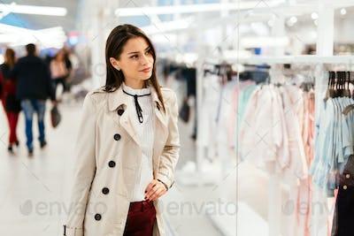 Beautiful woman shopping clothes