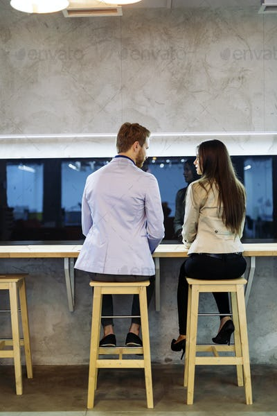 Man approaches woman in a bar