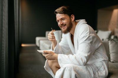 Handsome man drinking tea