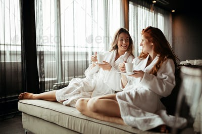 Women in bathrobes enjoying tea