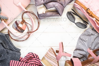 Woman clothes and accessories flat lay background