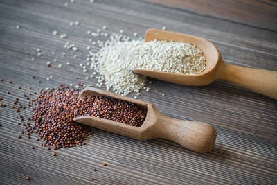 Scoops of white and red quinoa