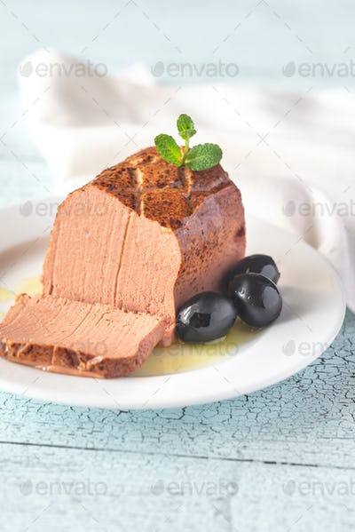 Chicken liver pate on the white plate