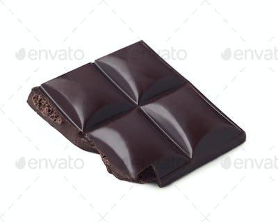 piece of shiny black chocolate isolated on white background