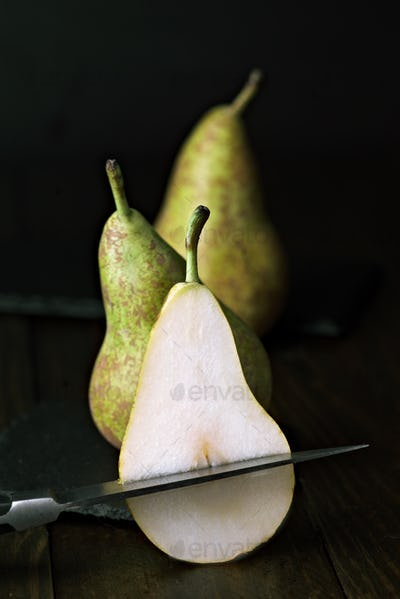 group of green pears on classic wooden table