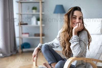 Portrait of woman smiling at the camera at home.