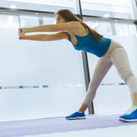 Beautiful woman stretching and exercising