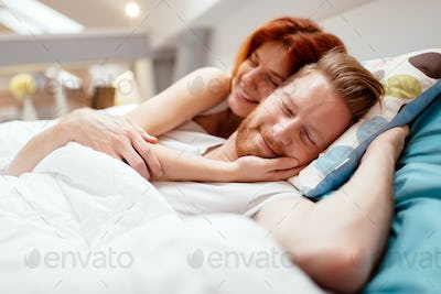 Beautiful couple romance in bed