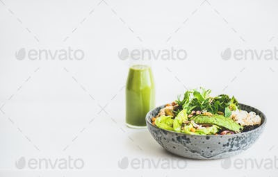 Healthy vegan superbowl and green smoothie, copy space