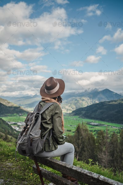 Young girl with a backpack outdoors