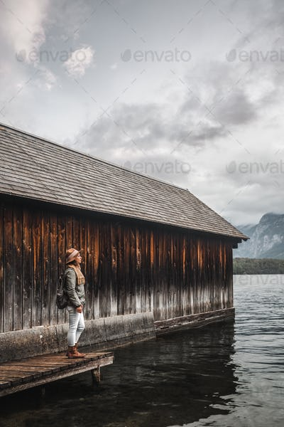 Young traveler with a backpack by the lake