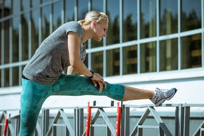 woman runner stretching exercise