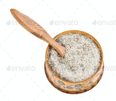 wooden salt cellar with spoon with seasoned salt