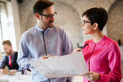 Portrait of two architects looking at project scheme