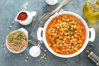 Indian Chana Masala, spicy chickpea curry with carrot and onion in tomato sauce