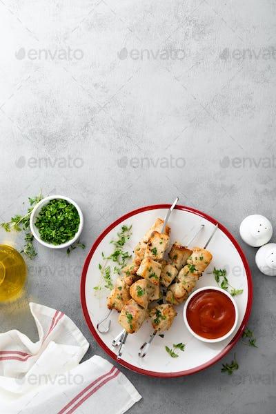 Grilled meat skewers, chicken shish kebab top view