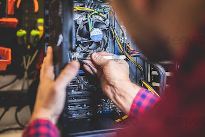 Man fixing PC in professional workshop.