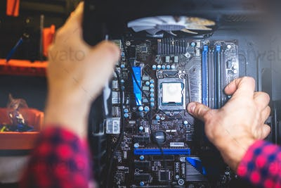 IT service and man fixing a PC