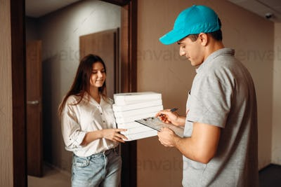 Female customer signs order, pizza delivery