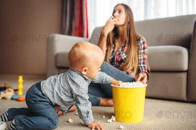 Little kid spilled popcorn, motherhood problems