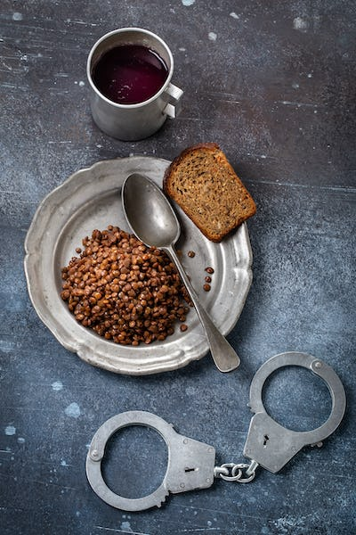 Prison food and handcuff above