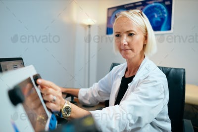 Doctor Woman Working In Hospital Office With Computer Technology Equipment