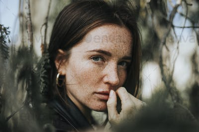 Portrait of a young woman with freckles