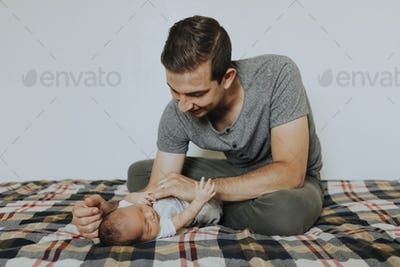 Young father holding his baby