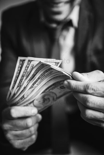 A person carrying a lot of cash