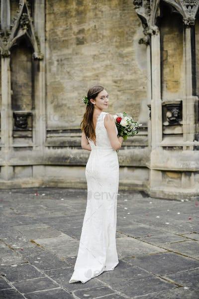 Bride waiting outside the church