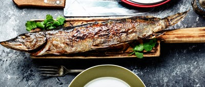 Pike stuffed with vegetables