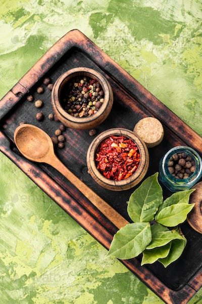 Spices and herbs on kitchen table