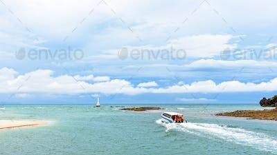 Speed boat is leaving the coast of Tarutao island
