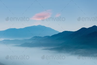 misty blue mountains at dawn,beautiful natural scenery in wuyuan