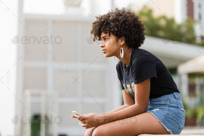 Outdoor portrait of a Young black African American young woman t