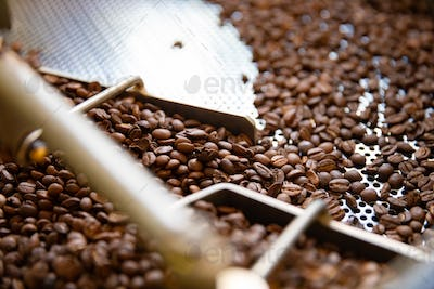 Side view of Raw Coffee Beans In Roaster Machine