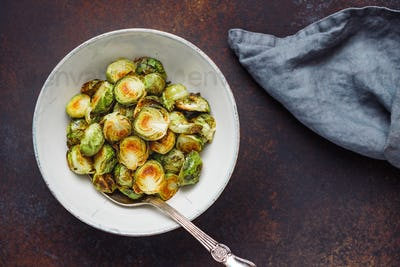 View from above on a ceramic bowl with roasted brussel sprouts