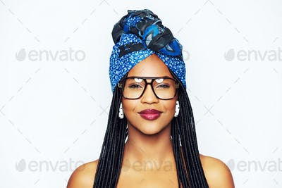 Smiling trendy black woman in headscarf