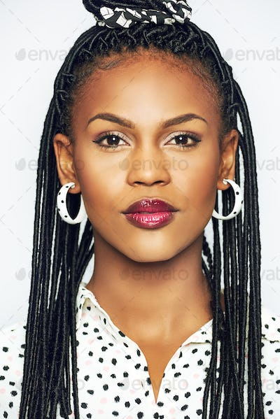 Portrait of elegant black woman with traditional hairstyle