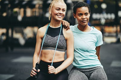 Fit young women smiling after a workout at the gym