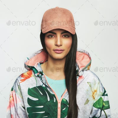 Beautiful woman in jacket and cap