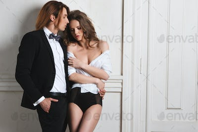 Sexy elegant couple in the tender passion.