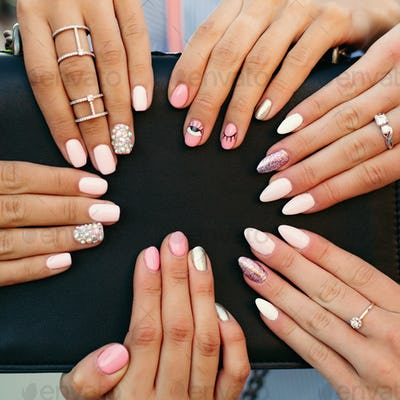Different fashionable and trendy manicure with design on girl s hands