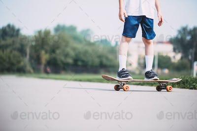 Closeup of skateboarder legs.